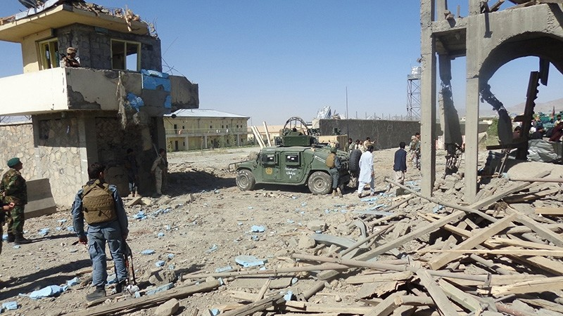 Afghan security officials inspect the scene of a suicide bomb attack that targeted police headquarters in Paktia, Afghanistan, June 18, 2017. (EPA Photo)