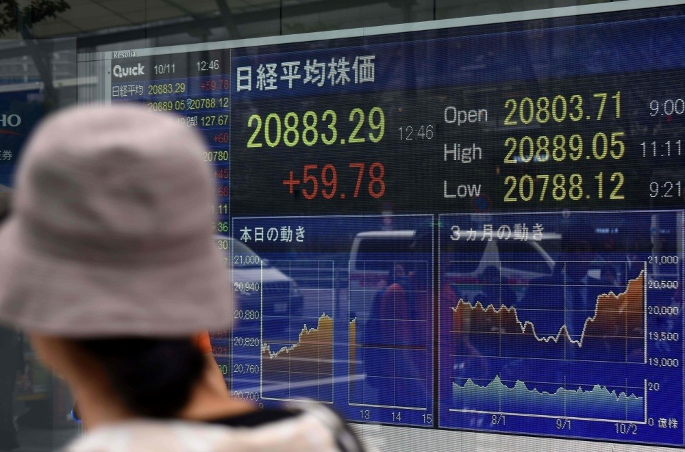 An electronics stocks indicator displays share prices of the Tokyo Stock Exchange, Oct.11