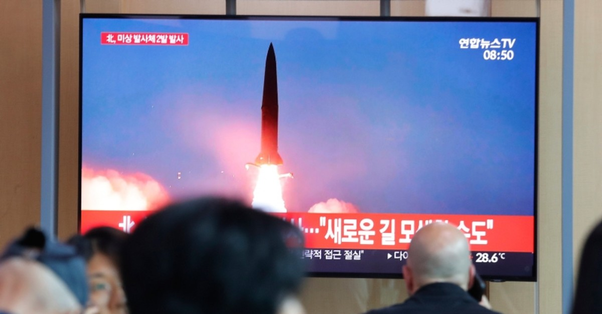 People watch a TV showing a file image of a North Korea's missile launch during a news program at the Seoul Railway Station in Seoul, South Korea, Tuesday, Aug. 6, 2019. (AP Photo)