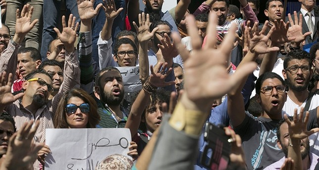 In this April 15, 2016 file photo, Egyptians shout slogans against Egyptian President Abdel-Fattah el-Sissi during a protest against the decision to hand over control of two strategic Red Sea islands to Saudi Arabia (AP Photo)