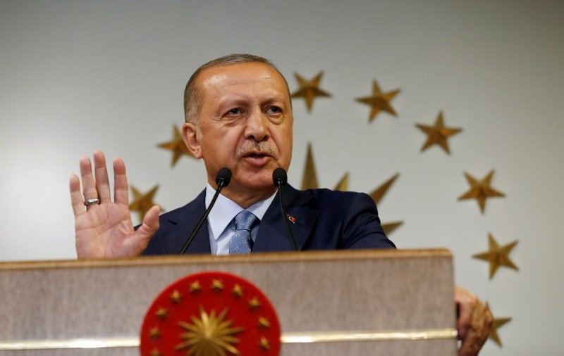 Turkey's President Recep Tayyip Erdogan delivers a statement on national television from his official residence in Istanbul, Sunday, June 24, 2018. (AP Photo)