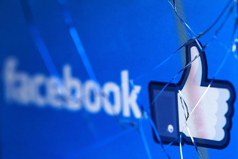 In this file photo taken on May 16, 2018 shows the logo of the social network Facebook on a broken screen of a mobile phone. (AFP Photo)