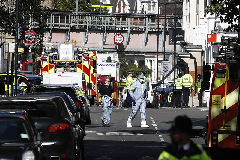 In this Friday, Sept. 15, 2017 file photo, police forensic officers walk within a cordon near where an incident happened, that police say they are investigating as a terrorist attack, at Parsons Green subway station in London. (AP Photo)