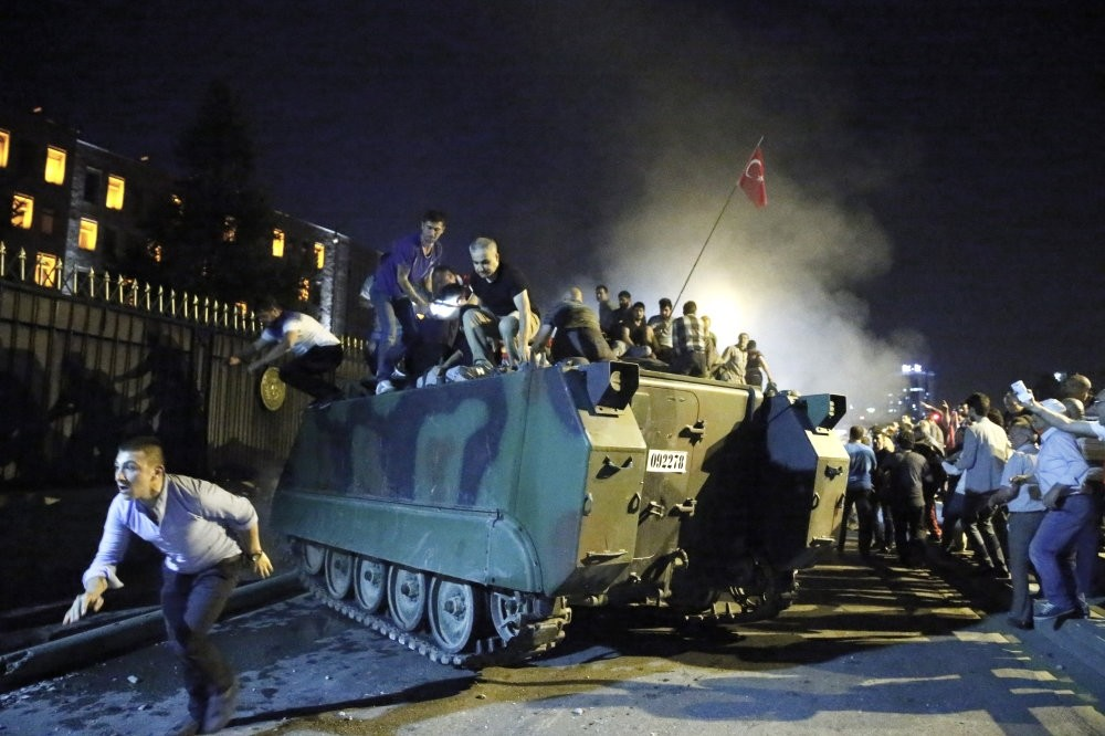 Anti-coup civilians protest against the coup attempt and surround a tank at military headquarters in Ankara on July 15, 2016.