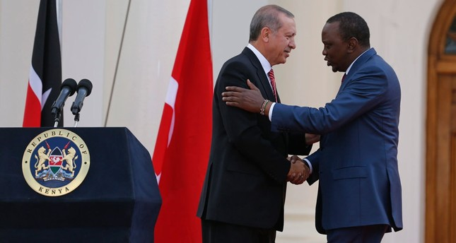 President Erdoğan (L) shakes hands with Kenyatta at the end of their joint press conference at State House in Nairobi, Kenya. Erdoğan & Turkish delegation were in Kenya to strengthen diplomatic & economic relations with the East African country.