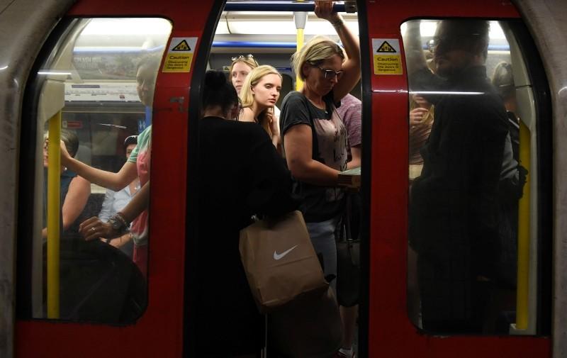 Commuters travel in the London underground in, July 24, 2018. (EPA Photo)
