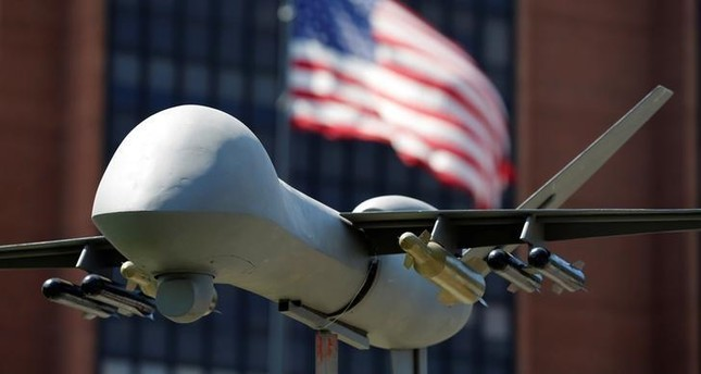 A model of a military drone is seen in front of an U.S. flag as protesters rally against climate change, ahead of the Democratic National Convention, in Philadelphia, Pennsylvania, U.S., July 24, 2016 (Reuters Photo)
