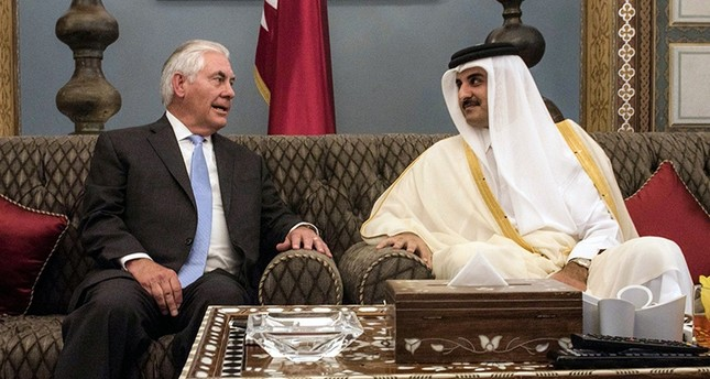 A handout picture provided by the U.S. Embassy in Doha on July 11, 2017, shows U.S. Secretary of State Rex Tillerson (L) meeting with Qatar's Emir Sheikh Tamim bin Hamad Al-Thani in the capital Doha. (AFP Photo)