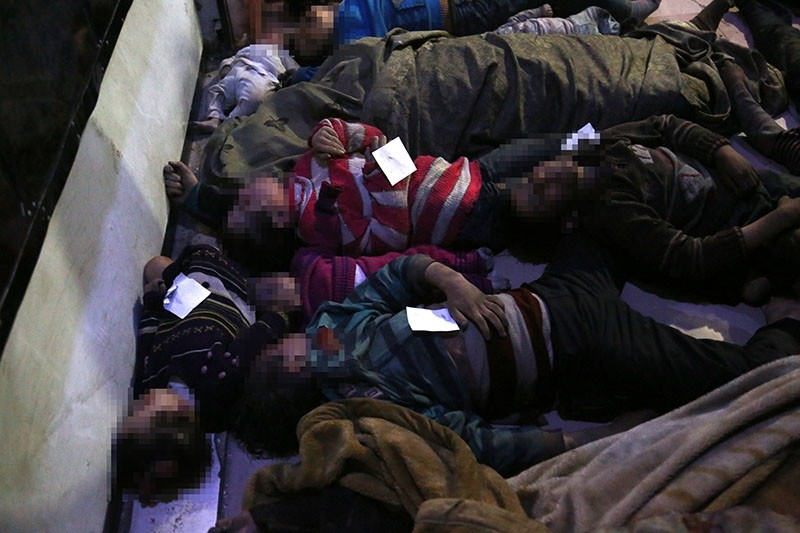 Bodies of victims of alleged chemical attack lie on the ground in opposition-held Douma, Syria, April 08, 2018. (EPA Photo)