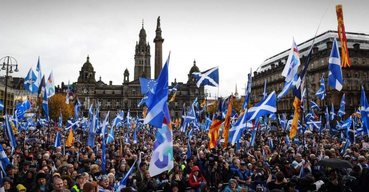Pro Scottish Independence campaigners listen as Scottish Nationalist Party (SNP) leader Nicola Sturgeon, Scotland's First Minister addresses a rally calling for Scottish independence in Glasgow on November 2, 2019. (AFP Photo)