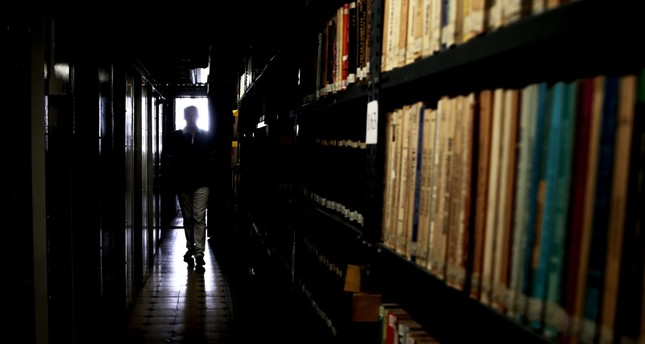 A man walks amid the bookshelves in a National Library in İzmir, Turkey, July 27.