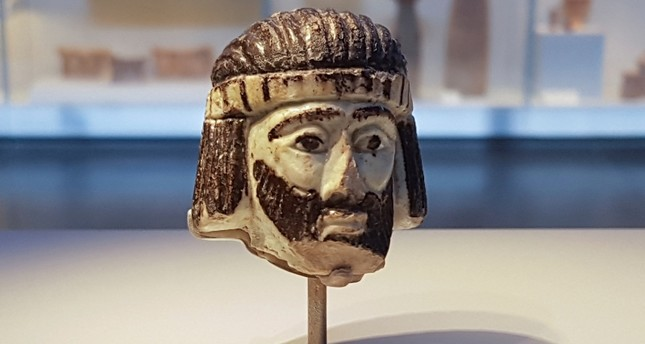 This Monday, June 4, 2018 photo shows a detailed figurine of a king's head on display at the Israel Museum, dating to biblical times, and found last year near Israel's northern border with Lebanon, in Jerusalem. (AP Photo)