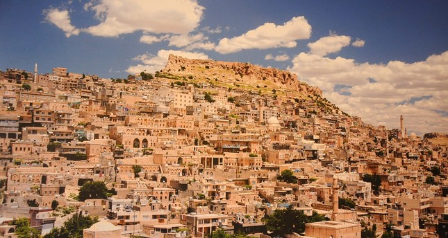 Situated on the outskirts of a hill crowned with an old castle, Mardin is known for its unique architecture composed of golden-colored houses.