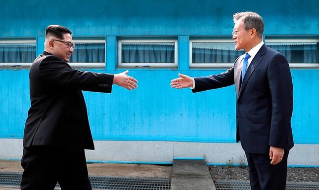 Image result for kim jong un and moon jae in handshake