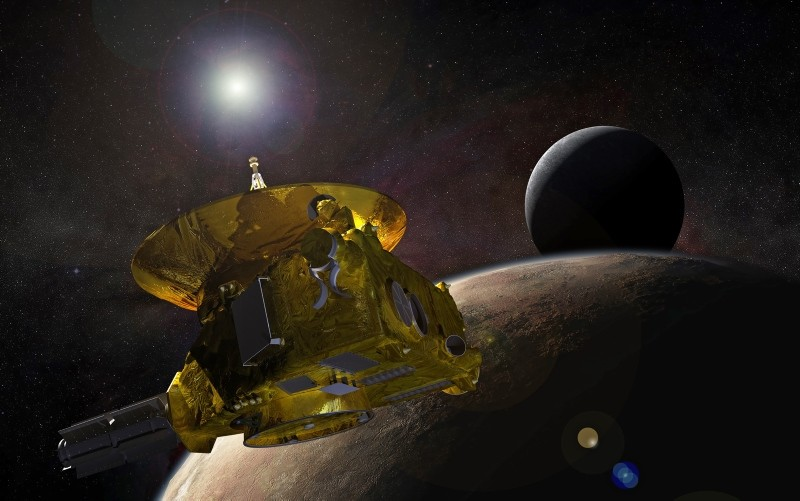 A handout photo made available by NASA shows an artistu00e2u20acu2122s concept of the New Horizons spacecraft as it approaches Pluto and its largest moon, Charon, in July 2015. (EPA Photo)