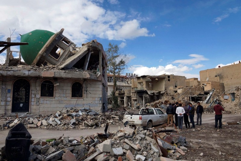 A group of Syrian Free Army activists inspect a damaged mosque at the Sheikh Yassine district area in the eastern city of Deir al-Zor February 16, 2013. (Reuters Photo)