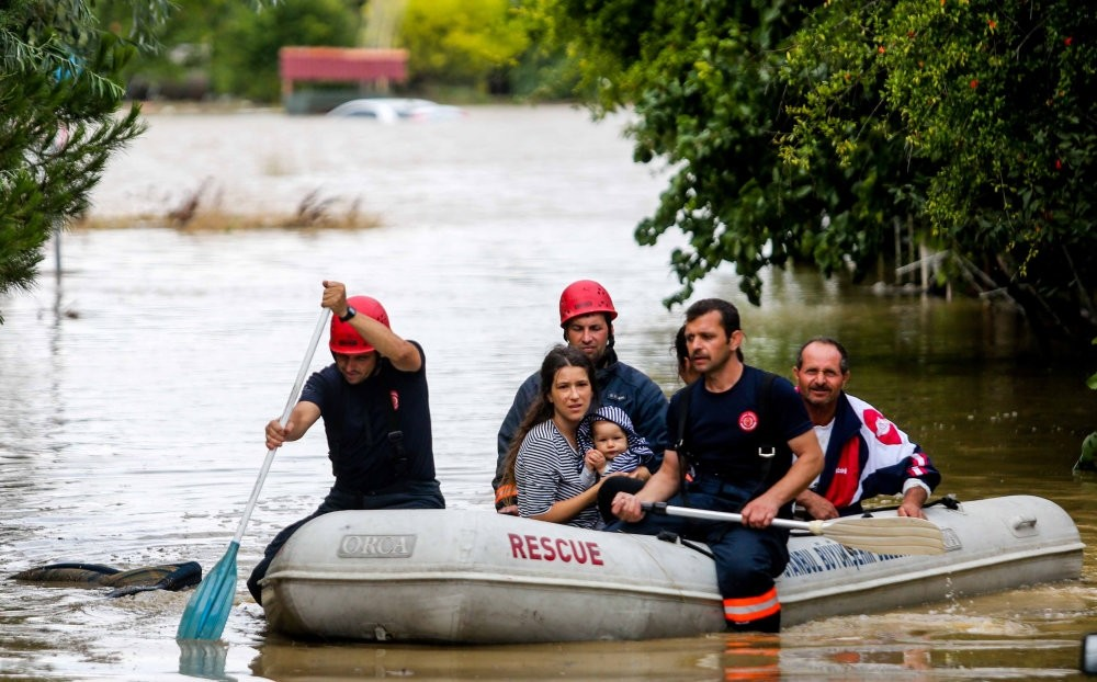 Fire fighters of Istanbul Metropolitan Municipality rescued people who trapped in their house due to flood with boats on July 27.