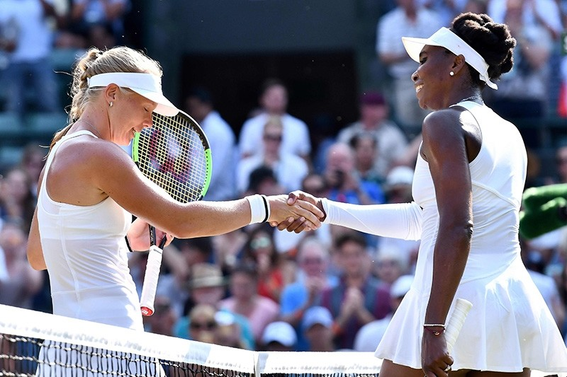 Netherlands' Kiki Bertens (L) shakes hands after winning against U.S. player Venus Williams during their women's singles third round match on the fifth day of the 2018 Wimbledon Championships at All England Lawn Tennis Club in Wimbledon. (AFP Photo)