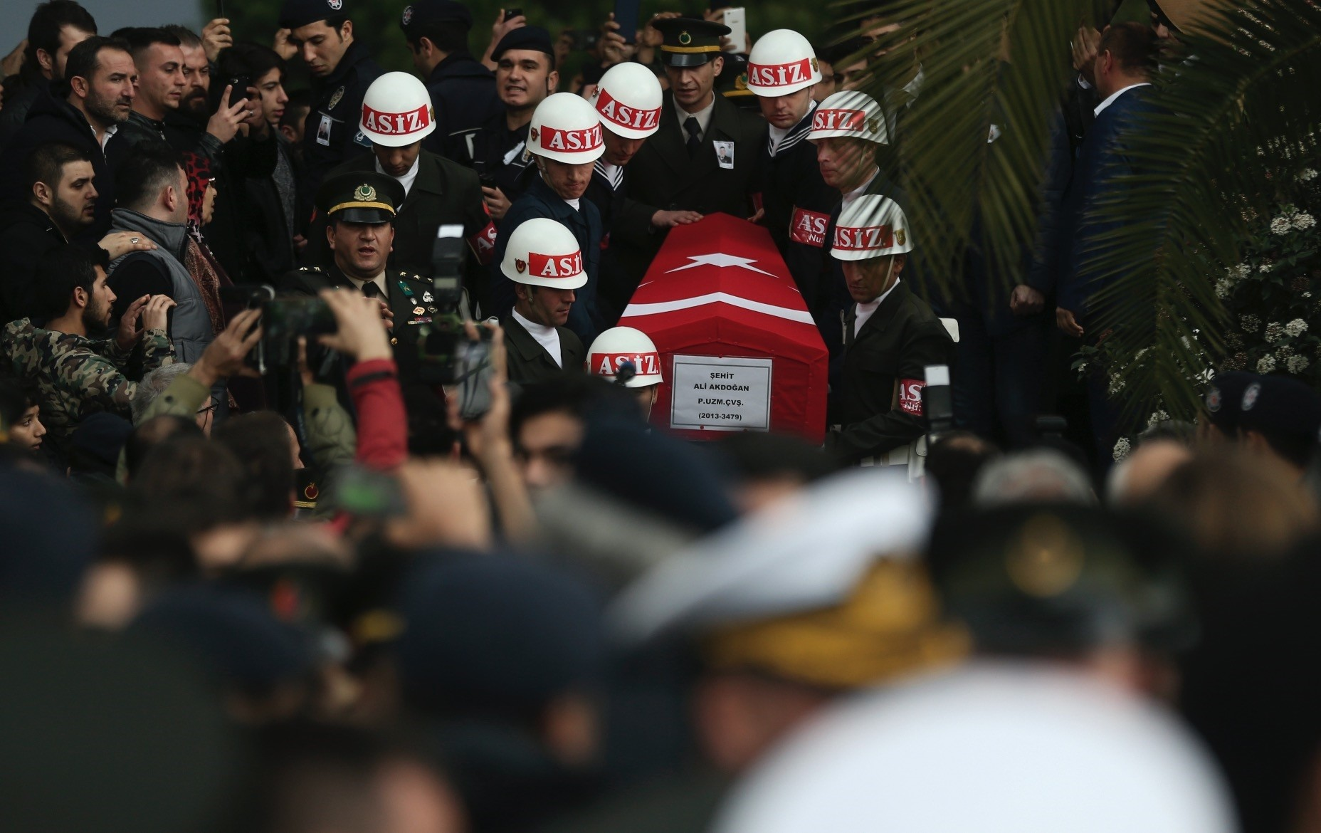 Soldiers carry the flag-covered coffin of Ali Akdou011fan, killed by U.S.-backed YPG terrorists during Turkeyu2019s counterterrorism operation in Afrin, at a funeral ceremony, u0130zmir, Feb. 11.