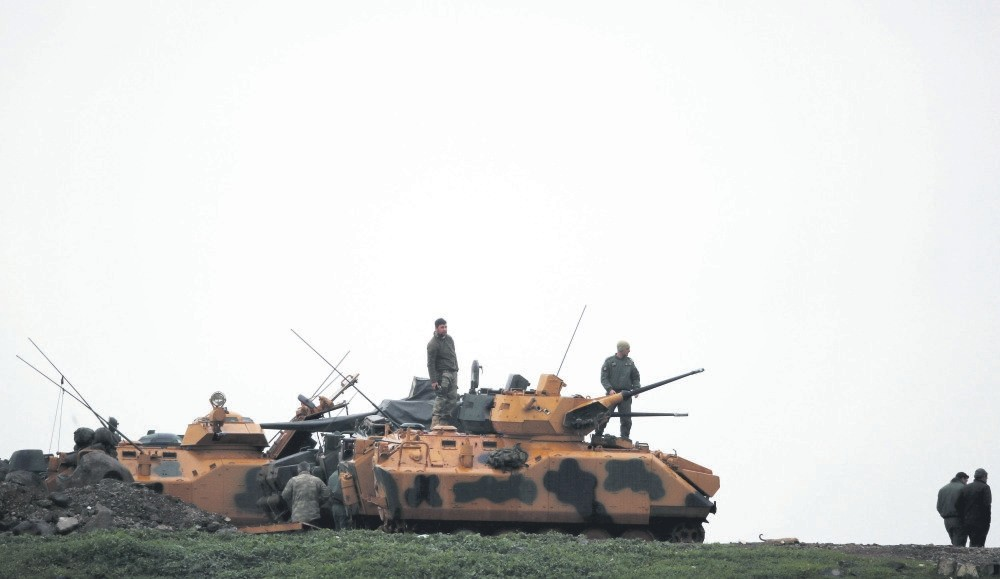 Turkish soldiers stand on an armored vehicle in a village near the Turkish-Syrian border, Hatay, Feb. 25.