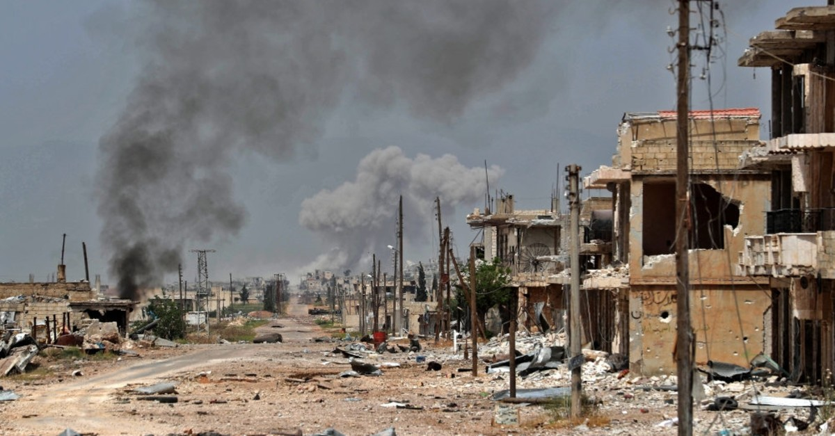 Plumes of smoke billow following a reported Syrian regime bombardment in Idlib, May 24, 2019.