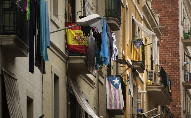 Balconies decorated with Esteladas or pro-independence flags and also a Spanish flag are seen in Barcelona, Spain.