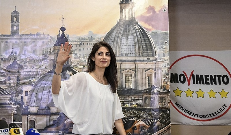Rome's Mayor Virginia Raggi of the 5-Star Movement waves at the end of a press conference in Rome, early Monday, June 20, 2016, soon after being elected. (AP Photo)