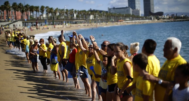 People form a human chain during a protest against tourism in Barcelona. The residents claim that the influx of tourists has increased the price of rents and produced a spike in rowdy behavior by party-seeking foreigners.