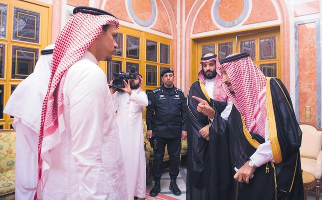Saudi King Salman (R) and Crown Prince Mohammed bin Salman (2-R) meet with the son of murdered Saudi journalist Jamal Khashoggi, in Riyadh, Saudi Arabia, Oct. 23.