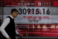Asian markets tumble after record breaking losses on Wall Street