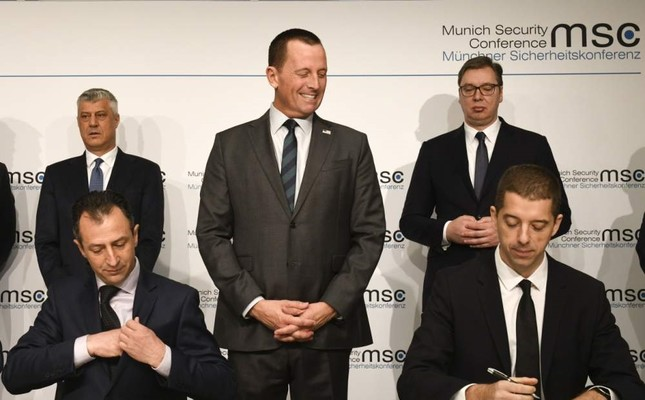 U.S. Ambassador to Germany Richard Grenell C, the President of Kosovo, Hashim Thaci on the left in the back, and Serbia Aleksandar Vucic on the right in the back watch the signing of an agreement between Kosovo and Serbia for railway and street projects at the Munich Security Conference MSC, Munich, Feb. 14, 2020. AFP Photo