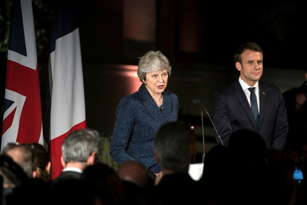 British Prime Minister Theresa May (L) and French President Emmanuel Macron (R) attend a reception at the Victoria and Albert Museum, Central London, Jan. 18.