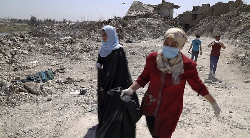 In this image made from video taken on Monday, April 9, 2018, bodies are recovered by volunteers in Mosul's Old City. (AP Photo)