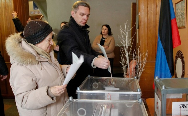 Local residents vote at a polling station during the election in the city of Donetsk controlled by pro-Russian rebels in eastern Ukraine, Nov. 11, 2018.