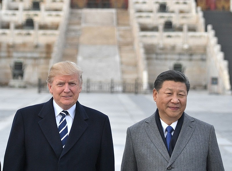 In this file photo taken on Nov. 8, 2017, US President Donald Trump, and Chinese President Xi Jinping pose at the Forbidden City in Beijing. (AFP Photo)