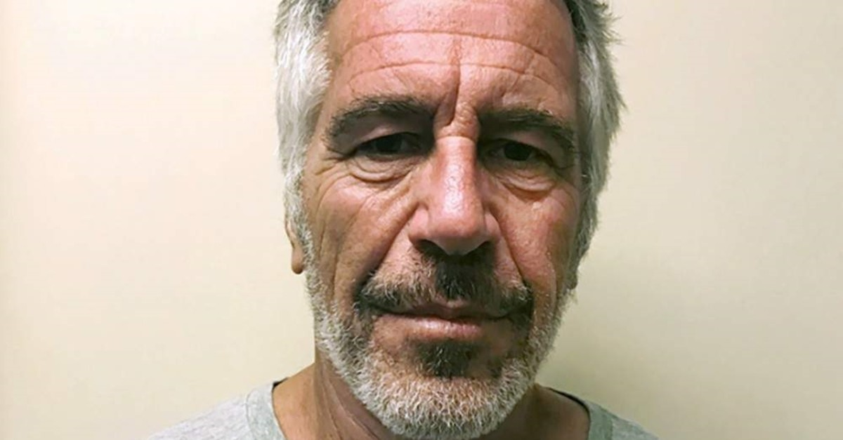 FILE - This March 28, 2017, file photo, provided by the New York State Sex Offender Registry, shows Jeffrey Epstein. Dr. Michael Baden, a pathologist hired by Jeffrey Epstein's brother, says he believes the financier's death at a New York City jail was a murder, not suicide. Baden told Fox News on Tuesday, Oct. 29, 2019, that some injuries found on the 66-year-old Epstein's body ,are extremely unusual in suicidal hangings, and more consistent with ,homicidal strangulation., (New York State Sex Offender Registry via AP, File)
