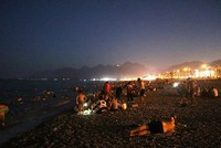 Record daytime temperatures pack beaches at night in Turkey's Antalya