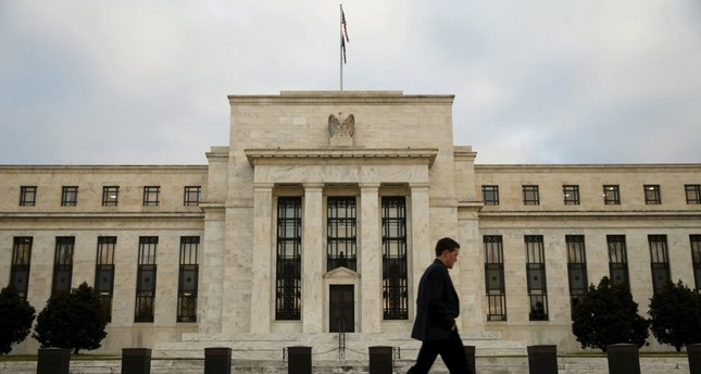 A man walks past the U.S. Federal Reserve building in Washington.