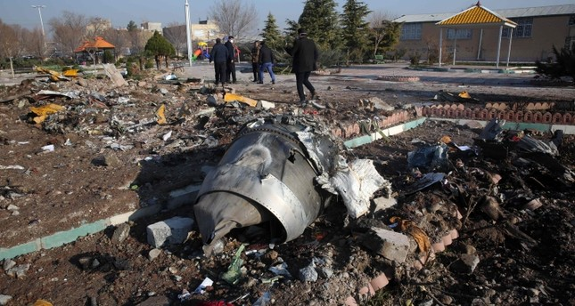 Rescue teams work amidst debris after a Ukrainian plane carrying 176 passengers crashed near Imam Khomeini airport in the Iranian capital Tehran early in the morning on January 8, 2020, killing everyone on board. AFP Photo