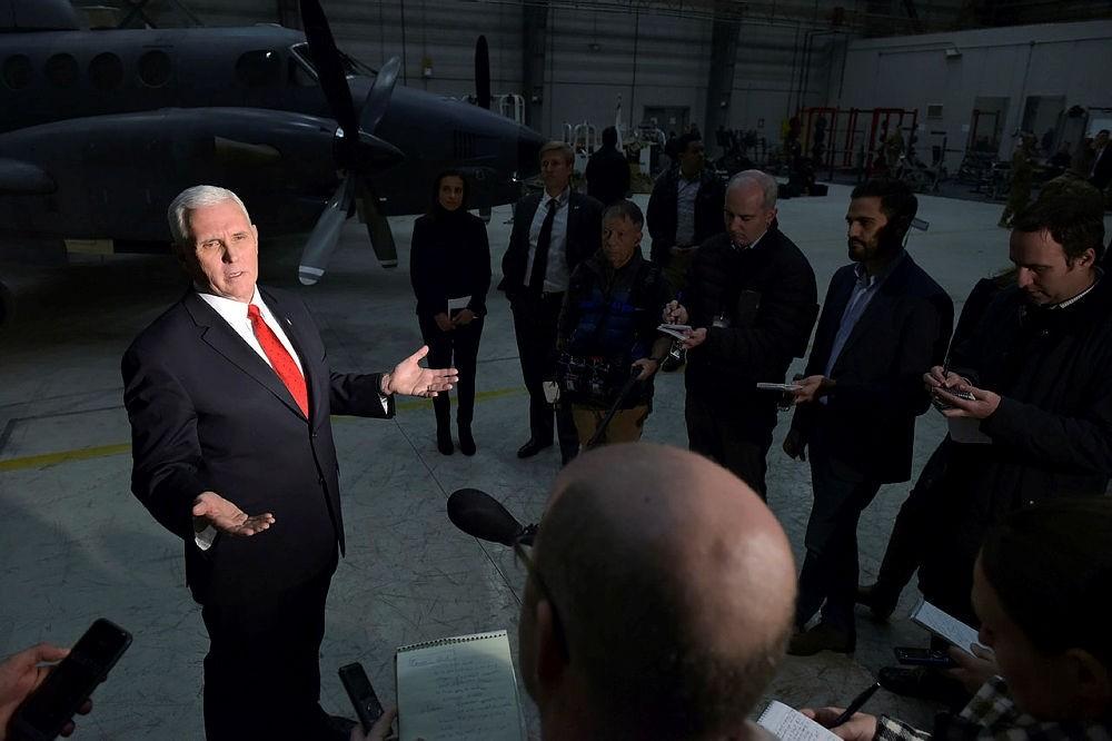 U.S. Vice President Mike Pence speaks to reporters in a hangar at Bagram Air Base in Afghanistan on Thursday, Dec. 21, 2017. (Pool via AP)