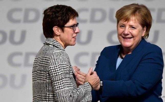 Annegret Kramp-Karrenbauer is embraced by German Chancellor Angela Merkel after being elected as the party leader during the Christian Democratic Union CDU party congress, Hamburg, Dec. 7, 2018. REUTERS Photo