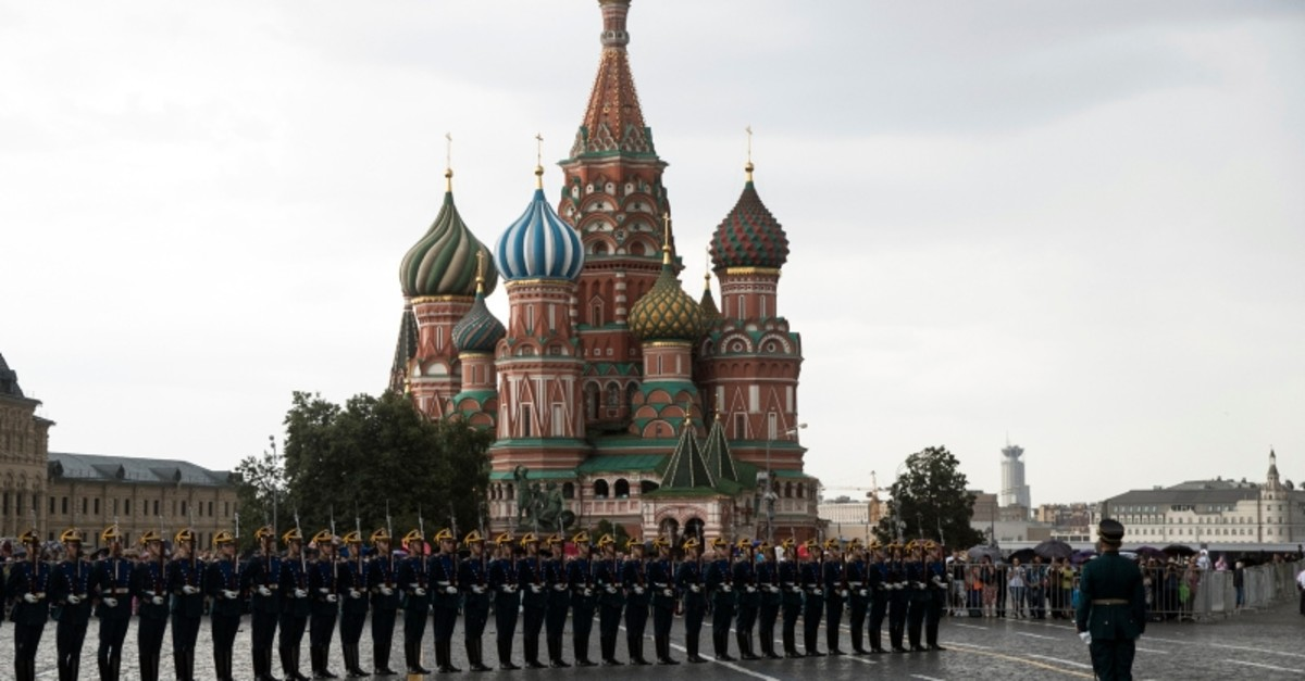 In this June 30, 2018, file photo, Kremlin guards perform in Red Square with the with St. Basil's Cathedral in the background, in Moscow, Russia. (AP Photo)