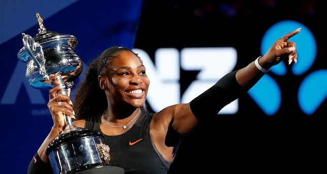 Williams holds her trophy after defeating her sister Venus during the women's singles final at the Australian Open tennis championships in Melbourne, Australia. (AP Photo)