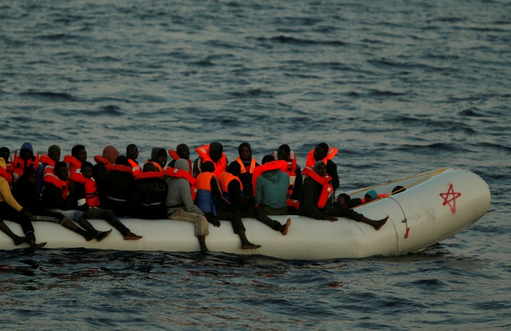 Migrants on a rubber dinghy awaiting rescue in international waters off the coast of Sabratha in Libya, April 15.