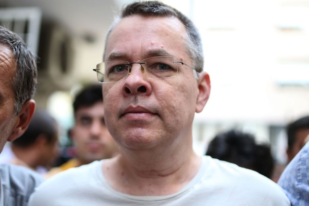 U.S. pastor Andrew Craig Brunson is escorted by Turkish police officers to his house in Izmir, July 25.