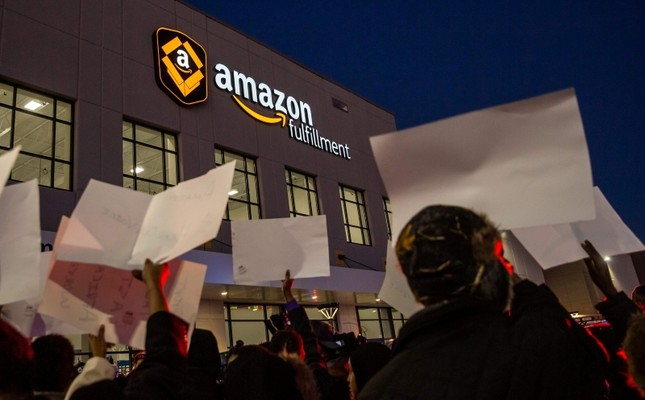 Demonstrators shout slogans and hold placards during a protest at the Amazon fulfillment center in Shakopee, Minnesota, on Dec. 14, 2018.AFP Photo
