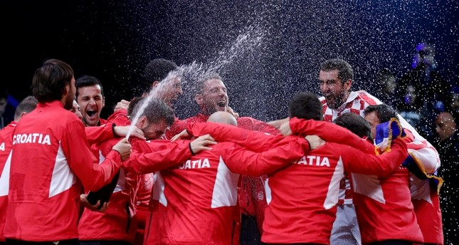 Croatia's team members celebrate their Davis Cup final win against France, Sunday, Nov. 25, 2018 in Lille, northern France. (Reuters Photo)