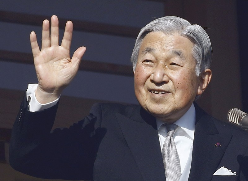In this Jan. 2, 2017, file photo, Japan's Emperor Akihito waves to well-wishers from the palace balcony during a New Year's public appearance (AP Photo)