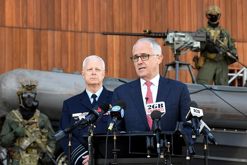 Australian Prime Minister Malcolm Turnbull (R) speaks to the media during a visit to Holsworthy Barracks in Sydney, New South Wales, Australia, 17 July 2017. (EPA Photo)