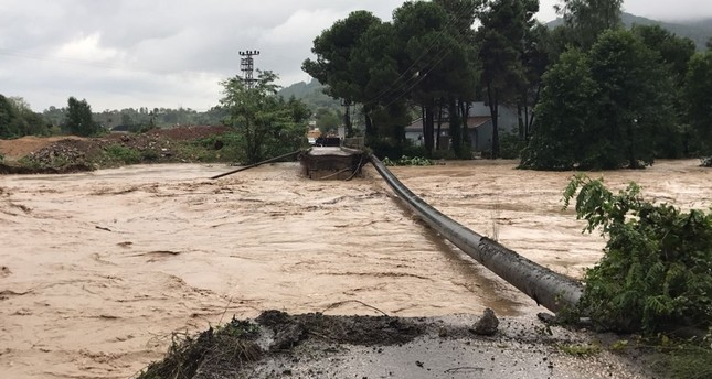 A bridge located in Cevizli stream in Ünye district collapsed after heavy rains, in Ordu, northern Turkey, Aug. 08, 2018. (DHA Photo)